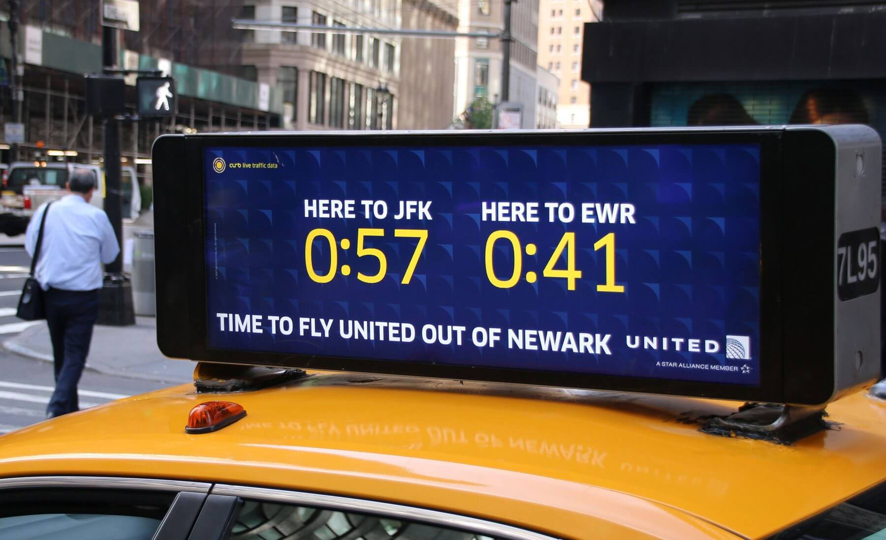 Digital taxi top on yellow taxi featuring United Airlines advertisement
